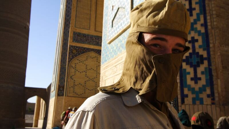 Portrait of Jamie Maddison in Bukhara wearing a Soviet-era desert face mask.