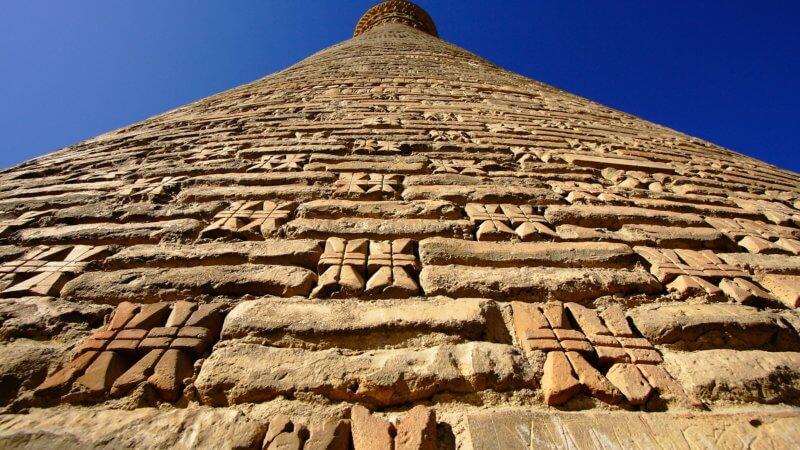 A close up shot of the Kalan minaret's stone construction.