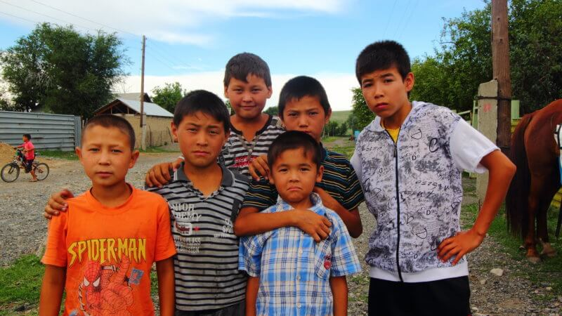 East Kazakhstan kids pose for a photograph in town.