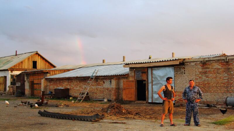 Two men stood outside a remote farmstead in eastern Kazakhstan near Lake Balkhash.