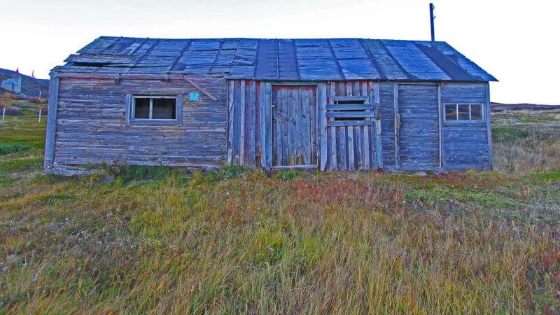 Side shot of an abandoned Norwegian fishing hut.