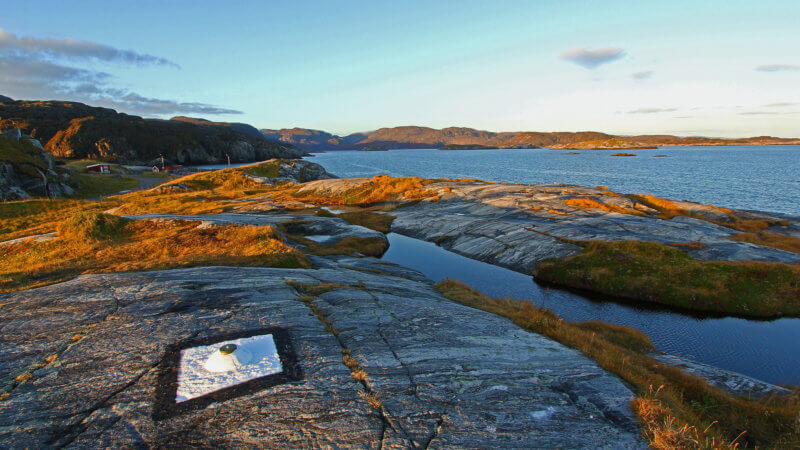 A survey point atop of a rock overlooking the Barents Sea.