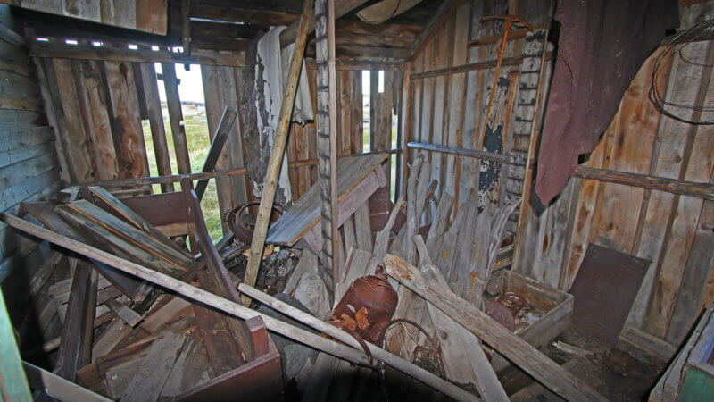 The inside of an old hut filled with disused fishing equipment in Grense Jakobselv.