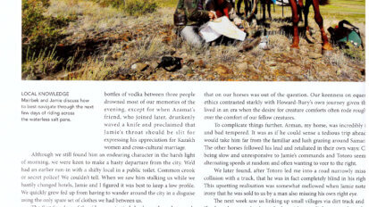 Tear sheet from Action Asia showing text and a photo of herder and horse rider looking over a map.