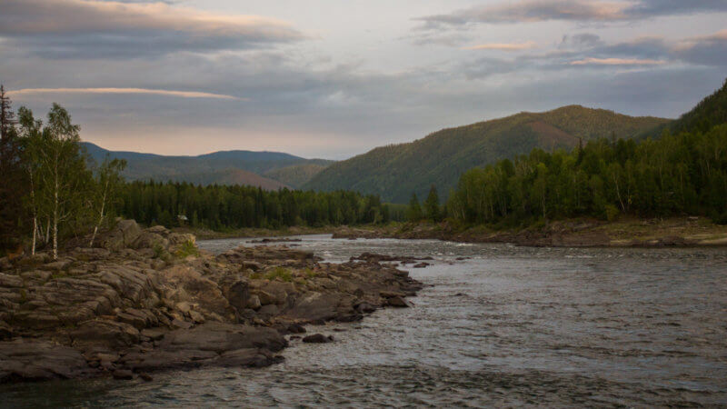 Upper section of the Yenisei River and rapids at dusk.