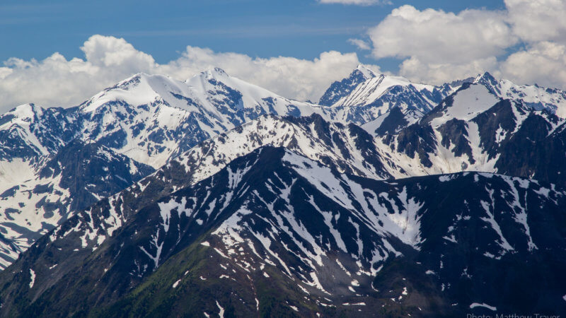 A collection of peaks in the Altai Mountains, partly covered in snow.