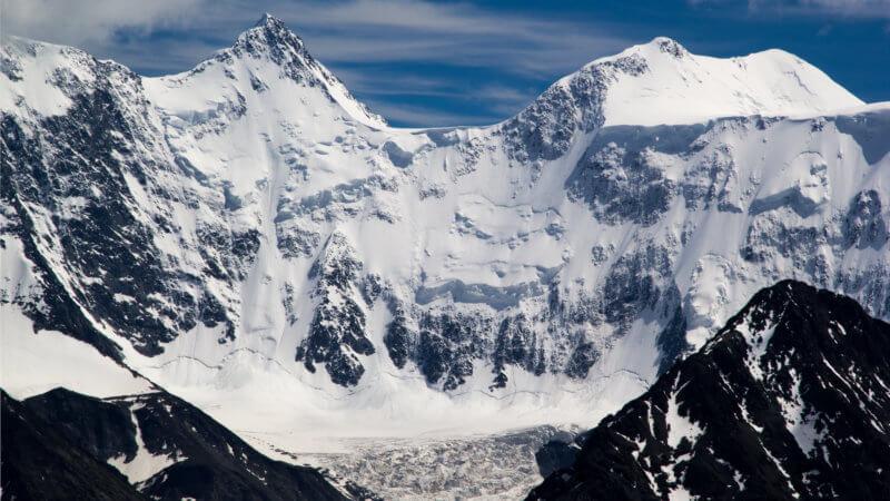 The alpine bowl and glacier beneath Belukha's pyramid-like face.
