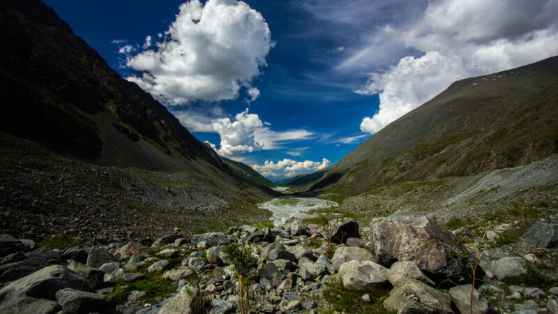 Wide view of a river valley leading out of Mount Belukha.