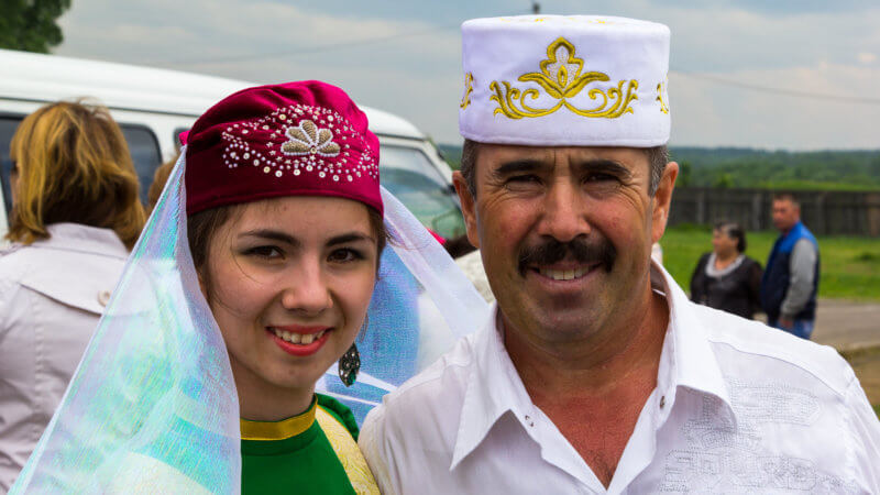 A Tatar man and woman wearing traditional hates.