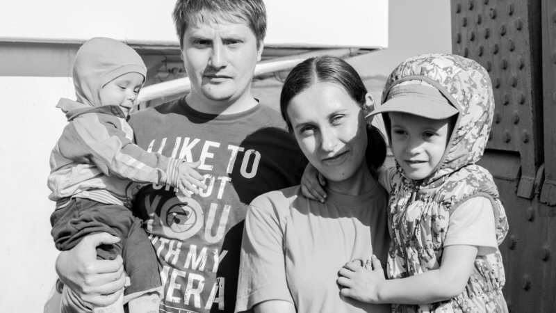Black and white photo of a Siberian family on board a river ferry in the Yenisei.