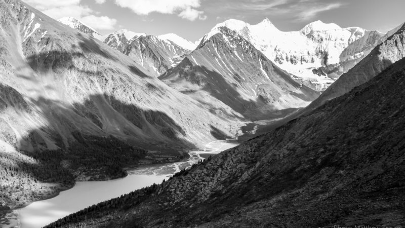 Black and white photo of clouds casting shadows on Mt. Belukha's main valley.