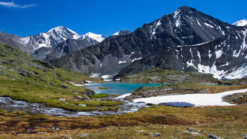 Turquoise coloured Altai Mountain alpine lakes and snow-capped peaks.