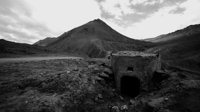 An old Soviet-era military gun station in southern Kyrgyzstan overlooks the road leading to Tajikistan.