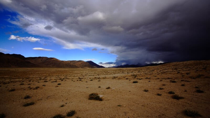 An enormous storm front passes over a stretch of desolate Pamir plateau.
