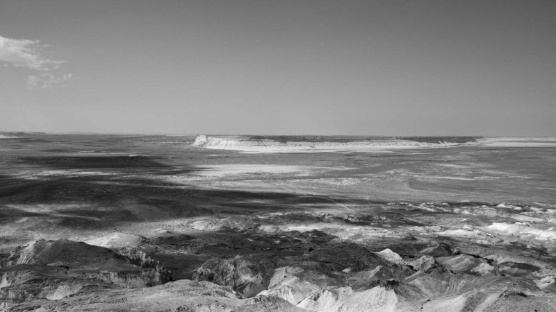 Looking down into an immense and inhospitable expanse of Ustyurt desert plateau that stretches into the horizon.