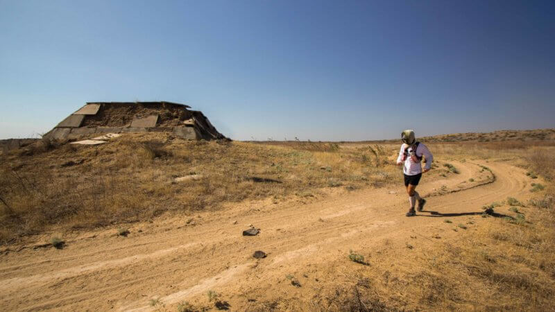 Jamie Maddison on an ultra-run across the Saryesik-Atyrau Desert and passing by the remains of an abandoned Soviet-era construction project.