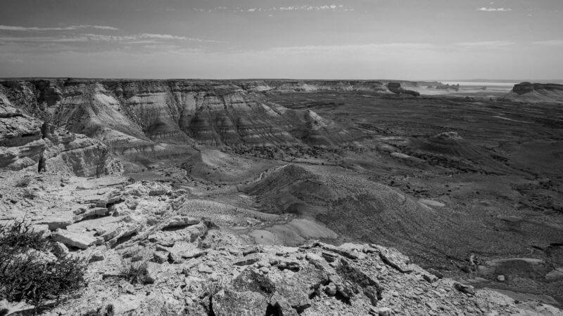 An expansive view of desert escarpment and flat plateau below.
