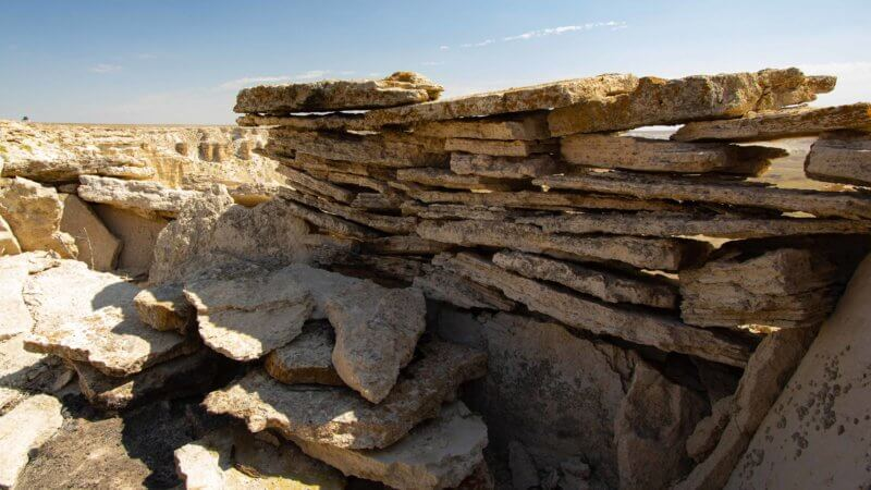Slabs of horizontal rock left behind from a prehistoric hunting pen in the Ustyurt.