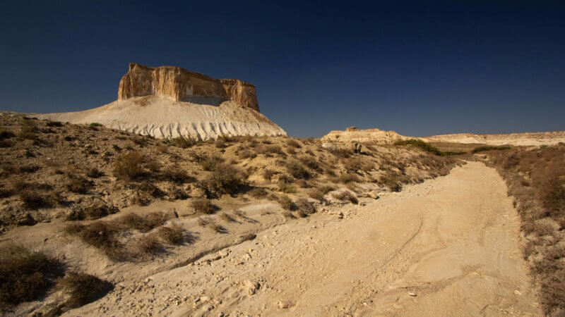 A dry, seasonal river bed cuts across a stretch of plateau in the Ustyurt of western Kazakhstan.