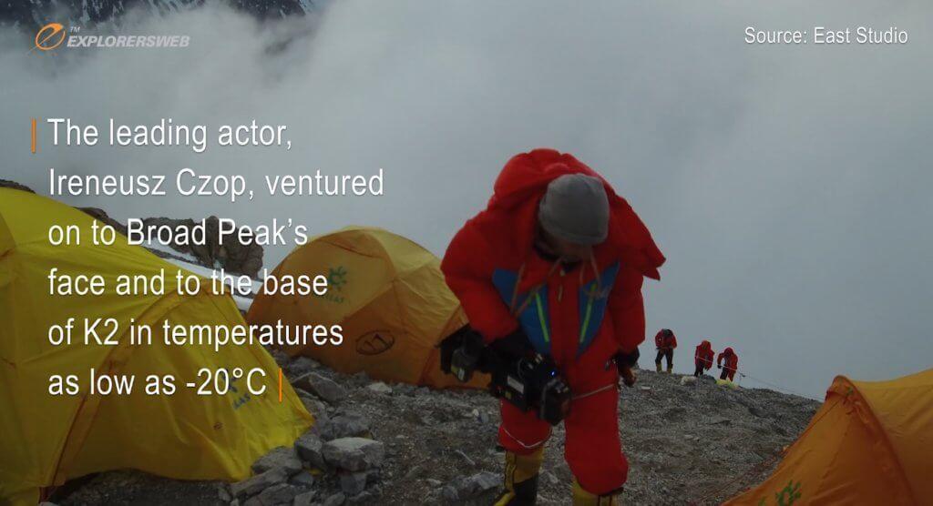 A Polish cameraman on the slopes of K2 walking past his Advanced Base Camp.