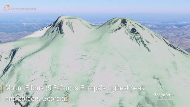 Google Earth 3D close-up shot of Mount Elbrus' twin peaks with the saddle in the middle.