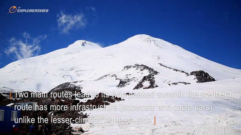 The two summits of Mount Elbrus seen a few hundred metres below from a mountain hut.