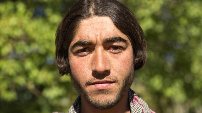 Afghan man with interesting hair cut poses.