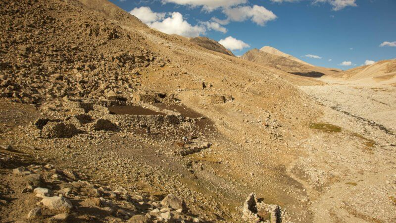 The outline of goat pens built from rocks in a Wakhan valley.