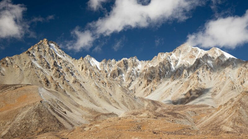 Wakhan mountain ridgeline, lightly covered in snow and glacial rubble.