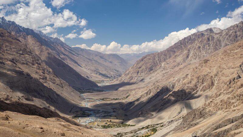 A wide landscape photo of the Wakhan Corridor looking towards Tajikistan.