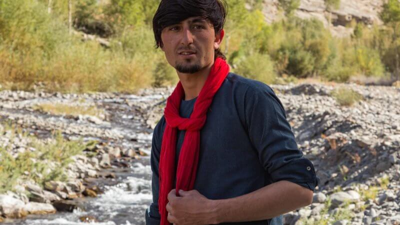 Photo of Wakhan Corridor guide wearing red scarf.