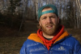 Screenshot of alpinist Max Fisher during an interview.