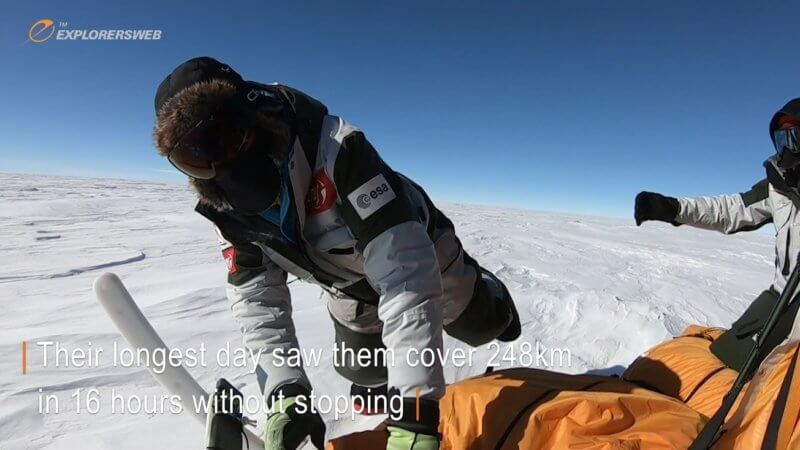 A Spanish explorer in Antarctica jumps on to a kite-powered sled as it's flying along.