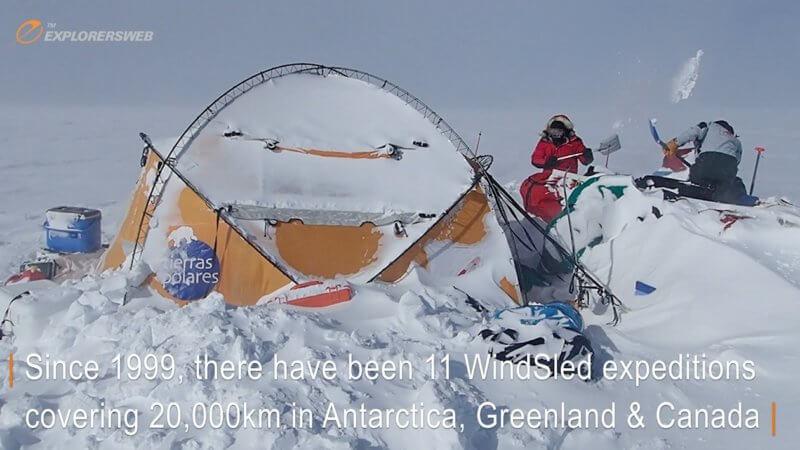 Antarctic explorers dig out a tent buried deep in snow.